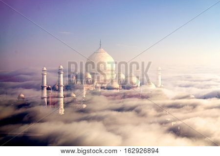 The TajMahal of Agra Surrounded with clouds and fog during the sunrise.One of the Seven Wonders of the World.