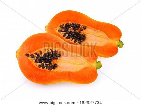 half of ripe papaya fruit isolated on white background