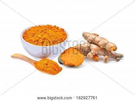 dried turmeric powder and turmeric root isolated on white background