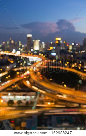 Twilight blurred bokeh lights interchanged with city downtown background