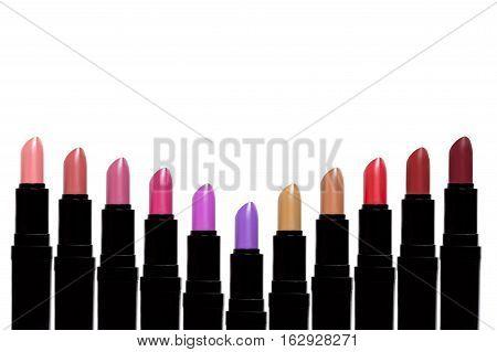 Set Of Color Lipsticks Forming V Shape. Lipstick Set Isolated On White Background