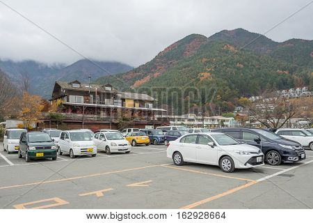 Kawaguchiko, JAPAN - 20 NOV 2016: View of commercial building in Kawaguchiko city with mountain and Fog