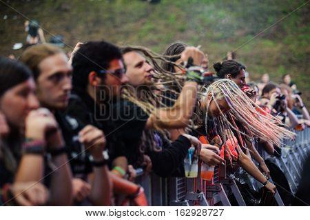 TOLMIN, SLOVENIA - JULY 25TH: HEAVY METAL FANS HEADBANGING AT THE METALDAYS FESTIVAL ON JULY 25TH, 2016 IN TOLMIN, SLOVENIA