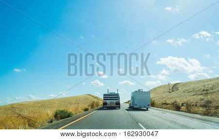 Truck overtaking a caravan in Interstate 5 California