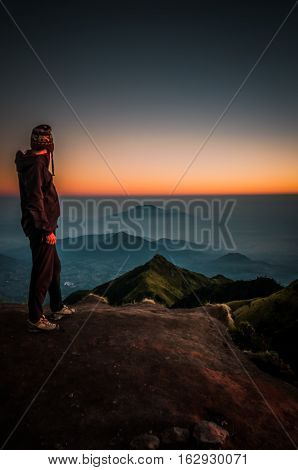 Hiker Looking At Mountains