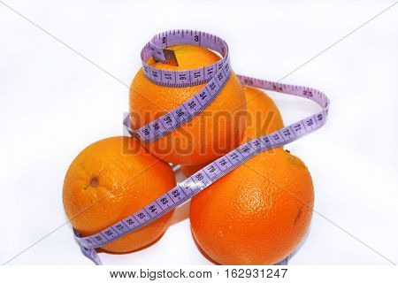 Abstract composition of Diet. Oranges with blue centimeter in.
