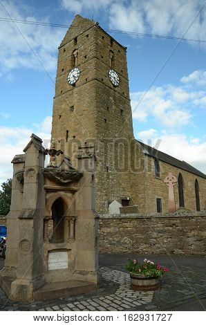 A view of the old church tower and fountain in Dunning
