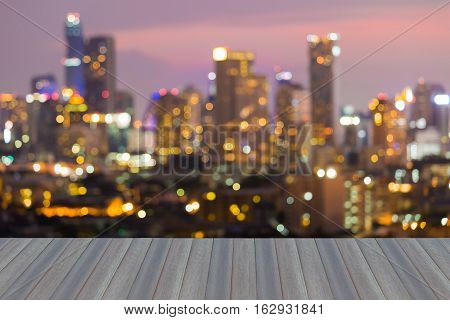 Opening wooden floor, City blurred lights night view, abstract background