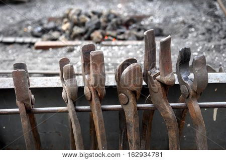 Blacksmiths`s tools ready to be used in a street forgery.