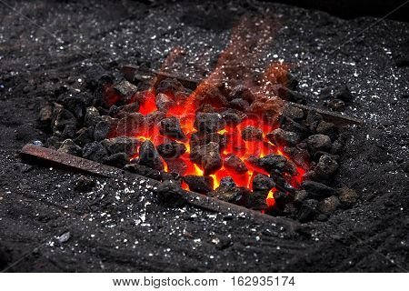 The hot forge of a street blacksmith.