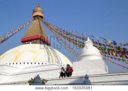 BODHNATH, NEPAL - DECEMBER 23, 2014: A young Nepalese couple at the Bodhnath Stupa near Kathmandu