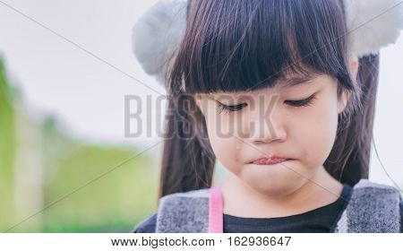 Crying child asian . . . .