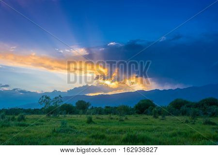 Bright beautiful summer sunset in the foothills of the Tien Shan Kyrgyzstan.