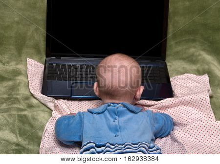 A small child in front of a laptop
