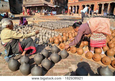 BHAKTAPUR, NEPAL - DECEMBER 29, 2014: Potters Square in Bhaktapur, Nepal
