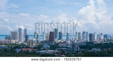 Penang island, tropical asian megalopolis. Beautiful city view with skyscrapers and the cloudy sky at the background.