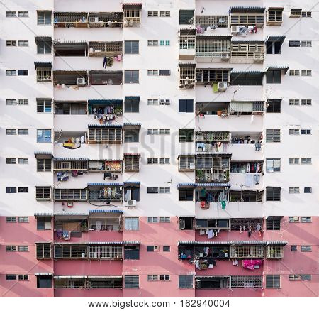 Frontal view of overcrowded residential building at asian city