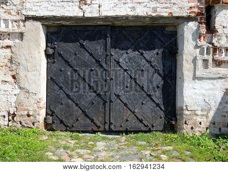 Old metal medieval gate in Kirillo-Belozersky monastery by day near City Kirillov Vologda region Russia.
