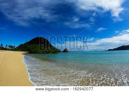 Kuta Beach at Lombok Island with pleasant smooth grain sand, Indonesia.