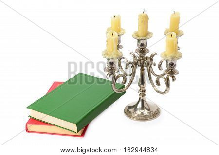sconce with candles and books isolated on white background