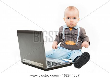 Happy Baby boy using laptop and having fun isolated on white