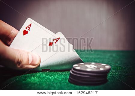 Hand Holding Best two aces Cards and Money Chips