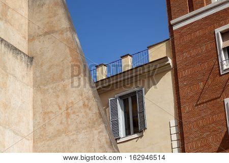 Building Facade With Windows, On Blue Sky, Rome, Italy