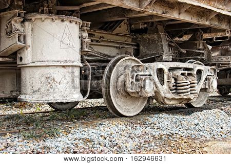 Old dirty wagons wheel of industrial train