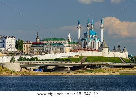 View of the Kazan Kremlin with Presidential Palace, Annunciation Cathedral, Soyembika Tower and Qolsharif Mosque from Kazanka River, Kazan, Russia.