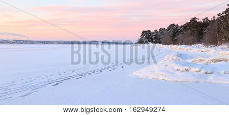 Path on the frozen lake on a clear winter morning. Karelia, Russia