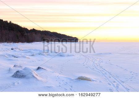 Idyllic snow landscape with beautiful winter sunrise