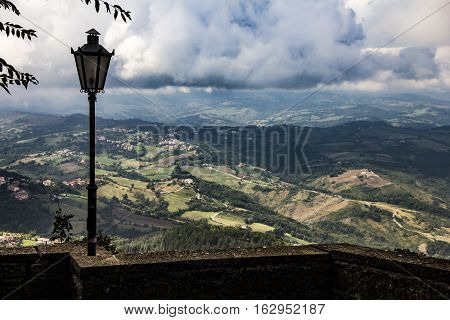 View of villages and landscape  with wall and lantern from the fortress of San Marino. The Republic of San Marino
