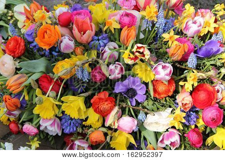Bright colors in a mixed flower spring bouquet