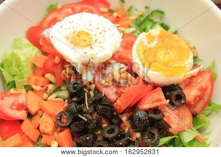 a Mixed salad with eggs and olives