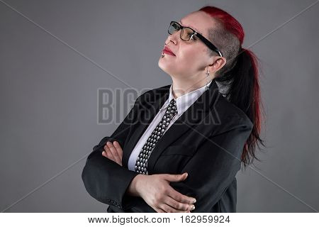 Looking up business punk woman on gray background