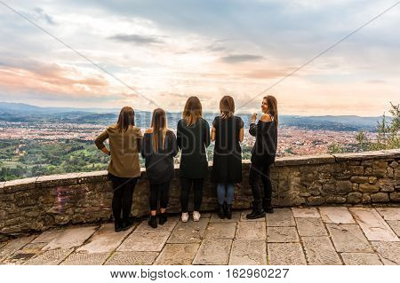 Fiesole Florence Italy - Oct 9 2016. Girls enjoy the panorama view of Florence from Fiesole Florence.