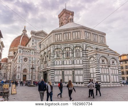FLORENCE ITALY - Oct 10 2016. Tourists on Piazza del Duomo in front of the cathedral of Florence - Dom Santa Maria del Fiore bell tower Campanile di Giotto and Baptistery