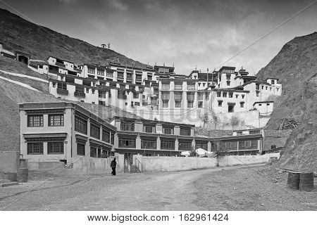Rizong monastery with view of Himalayan mountians - it is a famous Buddhist temple inLeh Ladakh Jammu and Kashmir India. Black and white image.
