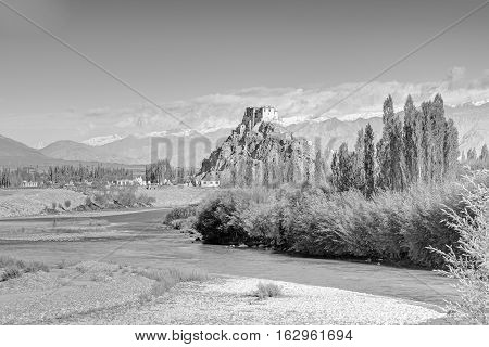 Stakna monastery with view of Himalayan mountians - it is a famous Buddhist temple inLeh Ladakh Jammu and Kashmir India. Black and white image.
