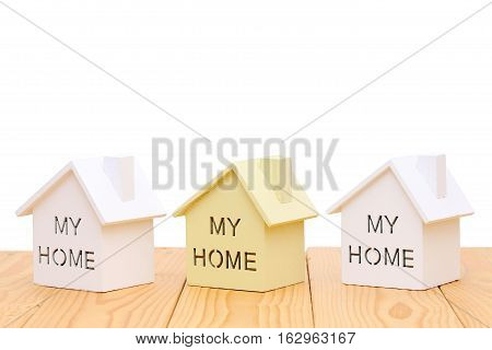 Miniature  model of house on table, white background