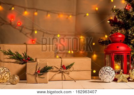 Image of christmas tree light on wooden table.