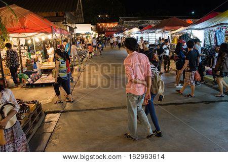 BANGKOK THAILAND - SEPTEMBER 17 2016: tourists walk to shop at Night market Srinakarin road or train market. This market is open every Wednesday to Sunday.