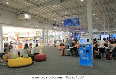 OSAKA JAPAN - OCTOBER 18, 2016, 2016: Unidentified people wait for flights at Kansai airport departure lobby.