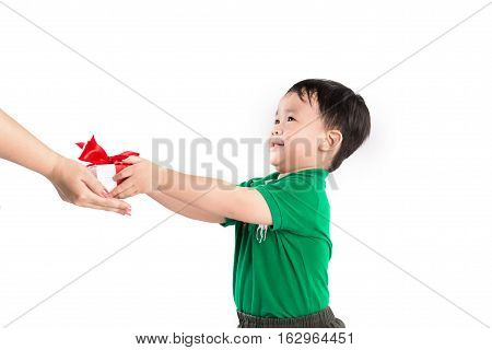 Son giving present to his mom over white background