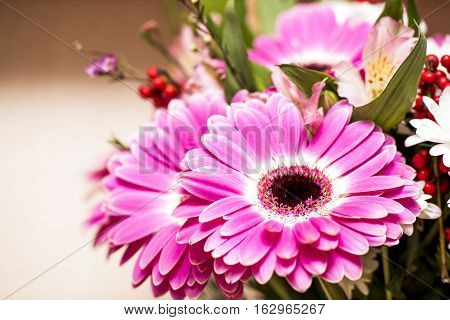 a bouquet of flowers combined with a predominance of red gerberas