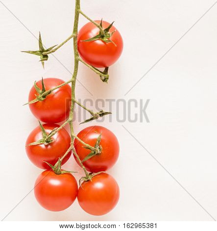macro image of cherry tomatoes on white background