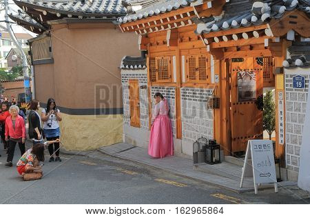 SEOUL SOUTH KOREA - OCTOBER 19, 2016: Unidentified people visit Bukchon Hanok Village. Bukchon Hanok Village is preserved to show a 600-year-old urban environment