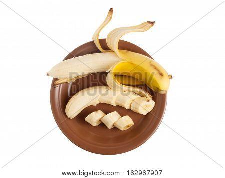 Plate with peeled and chopped ripe banana