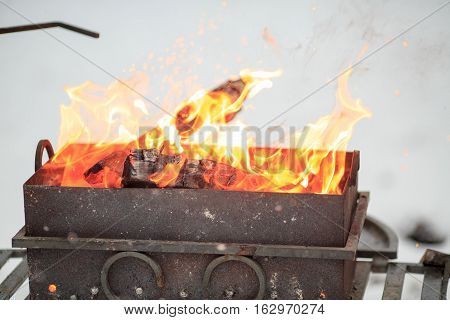 Flames From The Brazier Of Coals From Close Up.