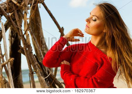 Beauty and fashion of women. Fashionable woman resting outdoor. Portrait of attractive gorgeous long haired lady in red.